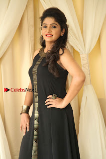 Divya Uruduga Pictures in Black Long Dress at Huliraaya Movie Audio Release Event