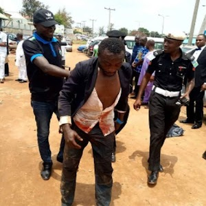 Car thief caught yesterday at Dunamis Church Abuja (Photos)