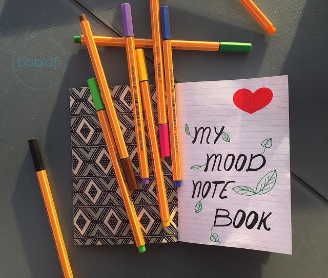 my mood note book écrit à la main en 1ère page du carnet avec des stylos stabilo