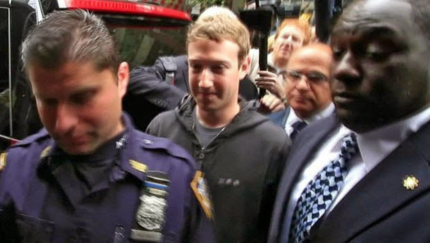 Facebook Inc. CEO Mark Zuckerberg is escorted by security guards as he departs New York City's Sheraton Hotel