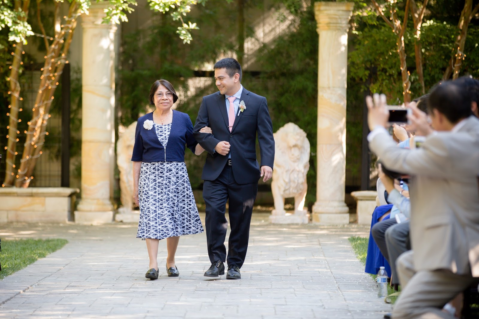 Groom and mom walking down the isle