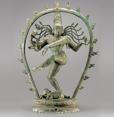 Shiva, as Nataraja, standing inside an arch of fire
