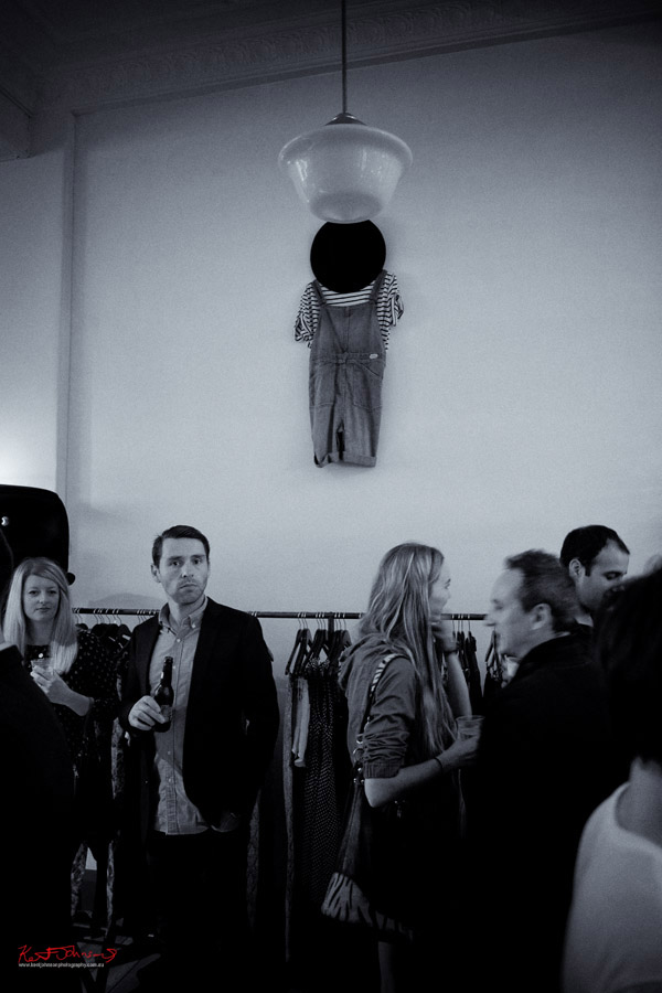 Denim playsuit as art on wall, people looking straight at me, Neuw Denim - Service Party - Fujifilm X-Pro1