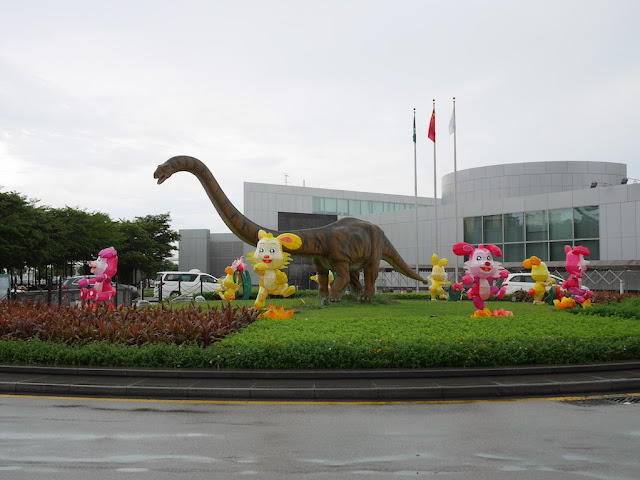 Mid-Autumn Festival lanterns and a large dinosaur on display in front of the Macau Science Center