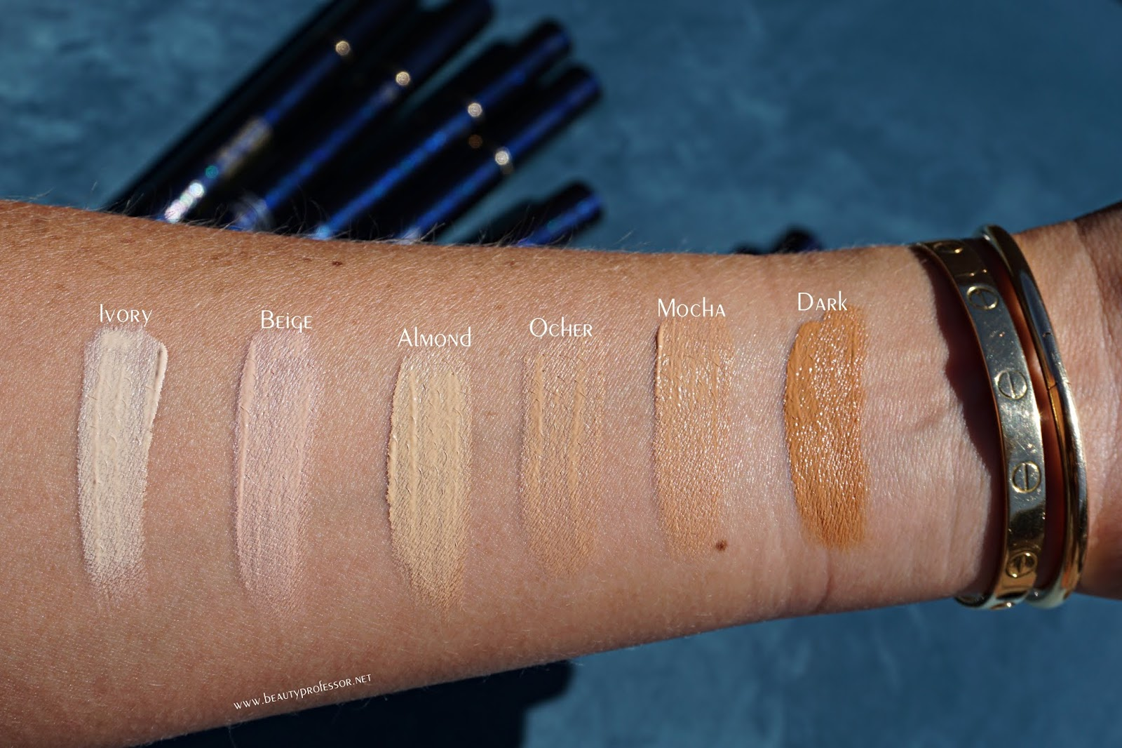 cle de peau radiant corrector for eyes swatches