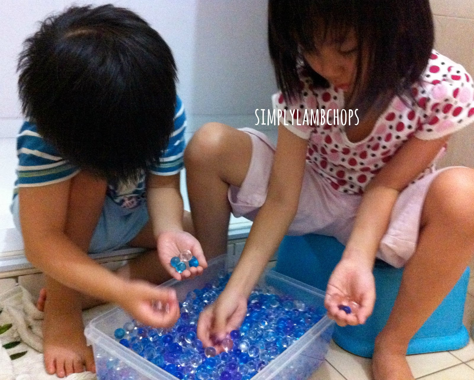 Water beads sensory play by Simply Lambchops