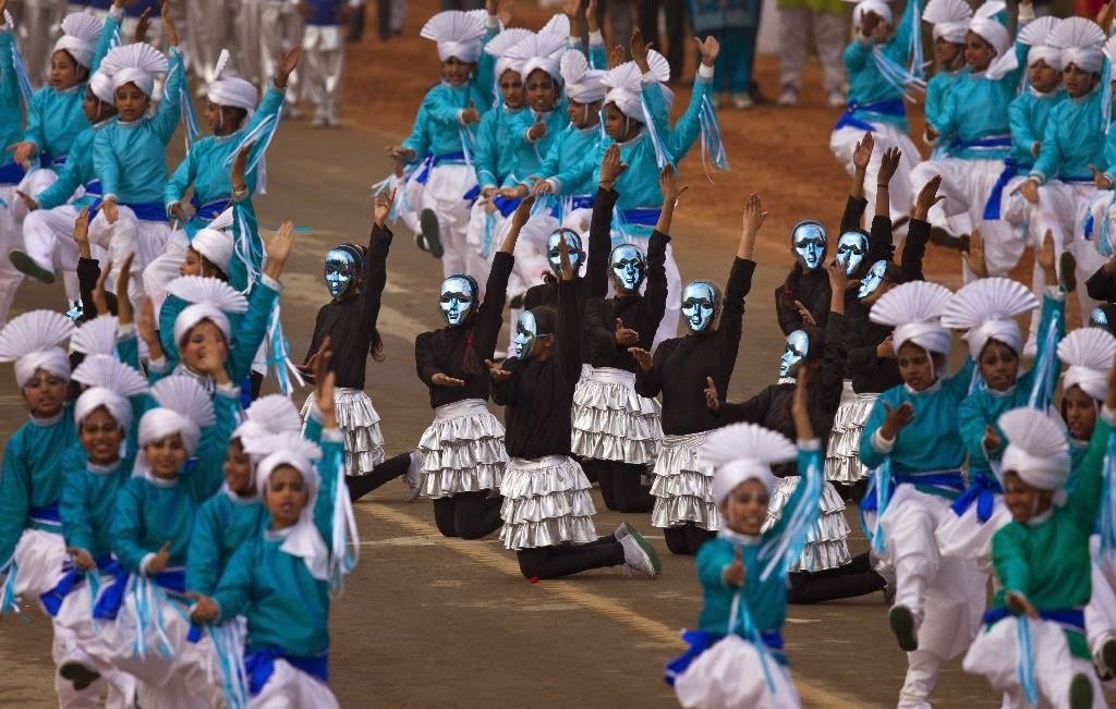 "Indian students perform a dance in colorful costumes during the full-dress rehearsal of Republic Day parade in New Delhi, India, Friday, Jan. 23, 2015. U.S. President Barack Obama will be the ""chief guest"" during this year's parade which will be held on Jan. 26."