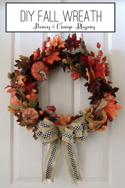 DIY Fall Wreath tutorial with fall leaves, gourds, pumpkins, burlap, and Mackenzie Childs ribbon