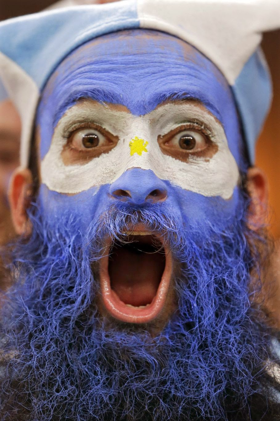 An Argentine supporter yells during the group F World Cup soccer match between Argentina and Bosnia at the Maracana Stadium in Rio de Janeiro, Brazil, Sunday, June 15, 2014.