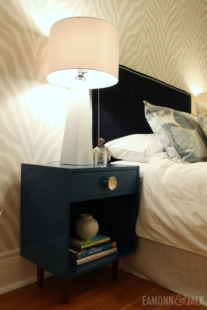Blue bedside table with brass hardware