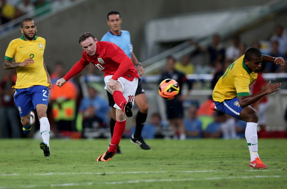 Wayne Rooney shoots to score England's second goal against Brazil