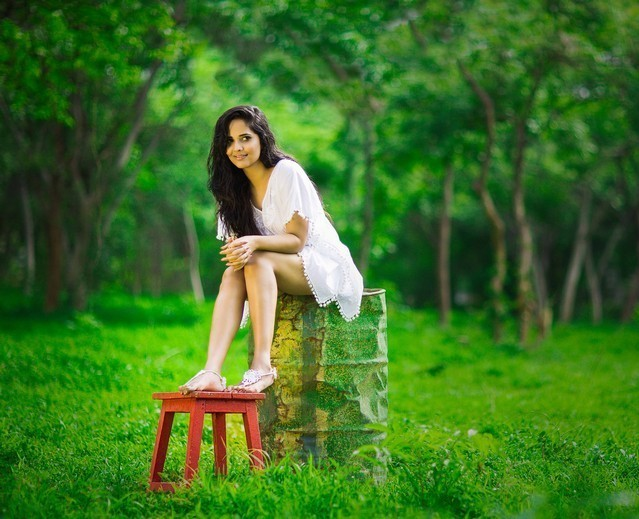Hot Tollywood Anchor Anasuya Photoshoot Stills In White Dress