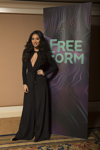 PLL actress Shay Mitchell in black jumpsuit