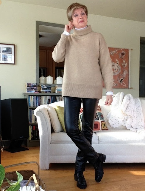 White Vince turtleneck, camel wool and cashmere Babaton sweater from Aritzia, black Holt Renfrew brand leather trousers, black Stuart Weitzman Brogan ankle boots.