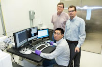 ORNL's Yang Song (seated), Dale Hensley (standing left) and Adam Rondinone examine a carbon nanospike sample with a scanning electron microscope. (hi-res image) (Credit: ornl.gov) Click to Enlarge.