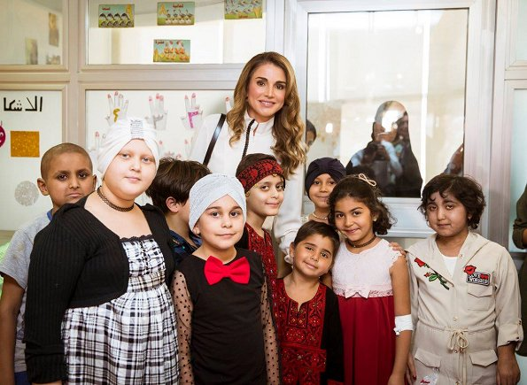 Queen Rania visited the Queen Rania Al Abdullah Hospital for Beyond Museum Walls' program. wore blouse and trousers