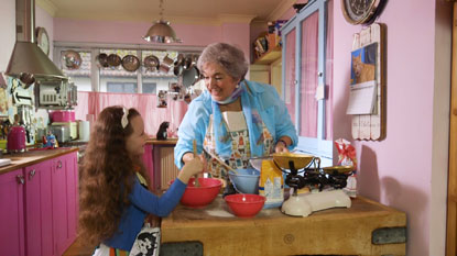 Girl and gran baking cakes for Cats Protection