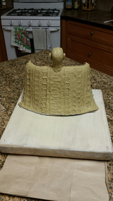Clay sculpture of an African man, in progress, by Lily L.