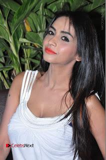 Actress Model Pooja Sri Stills in White Short Dress at F Club pre soft Launch  0076.JPG