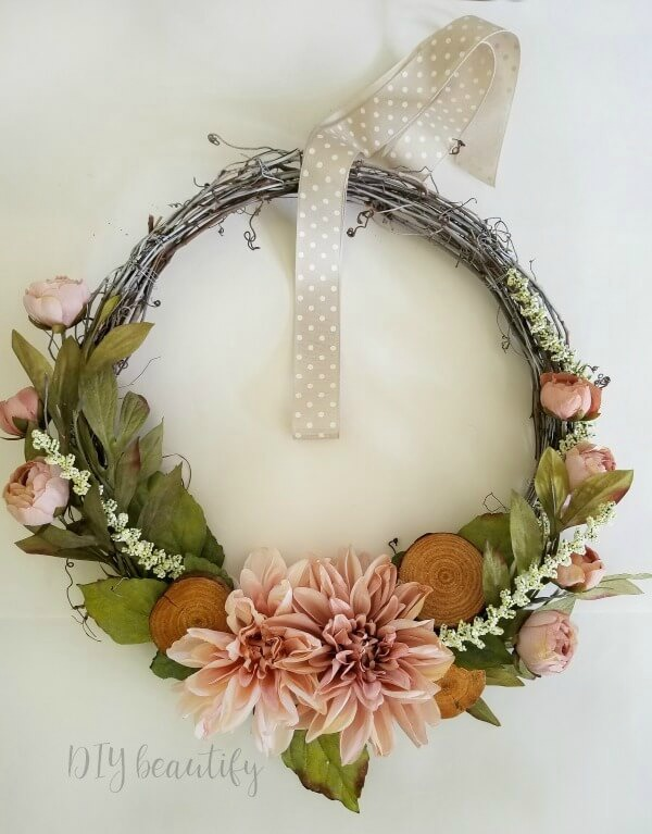 DIY spring wreath with blush florals on grapevine base