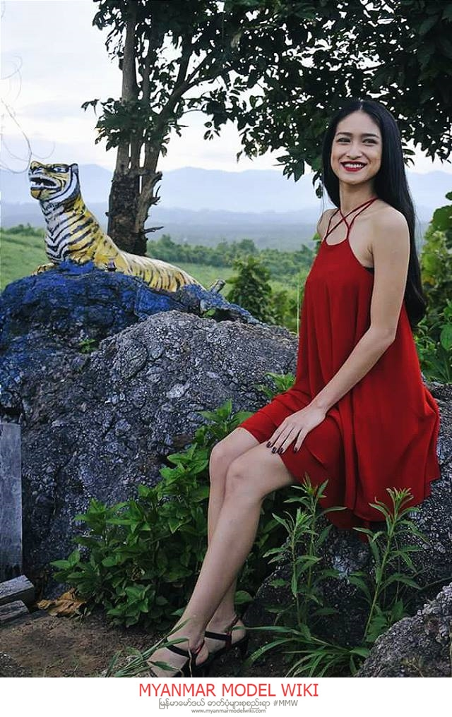 Shwe Eain Si In Red Fashion At Mya Wa Di Province With Mountains and Trees