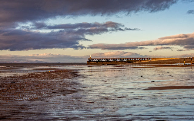Photo of Maryport pier at low tide