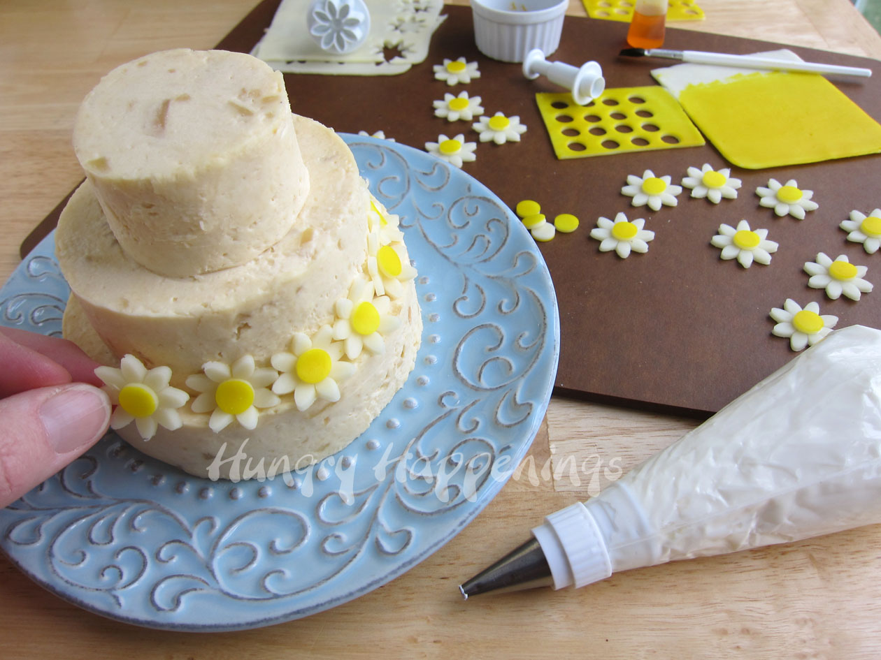 decorating a wedding cake with cream cheese icing wedding cake cheese special occasion appetizer 13396