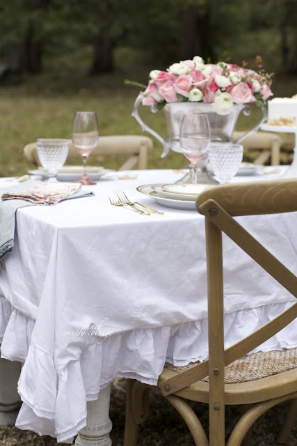 Ruffled duvet cover as tablecloth at outdoor tablesetting