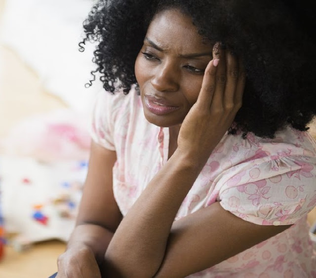 African woman stressed