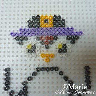 Adding in purple beads