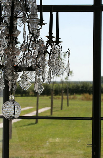 Crystal candelier, iron and glass windows, image via Garnier (be) as seen on linenandlavender.net