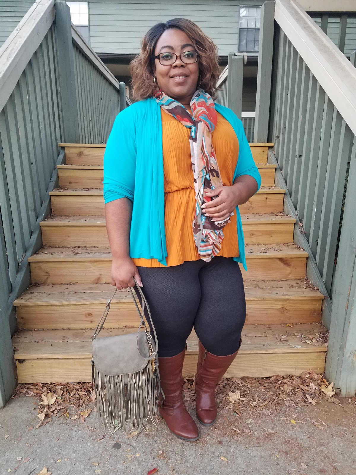 pleats, peplum hem, mustard blouse, teal cardigan, fringe bag, scarf accessory, cognac boots, thick thighs, round hips