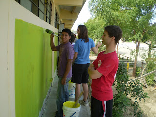 Kyle Durfee and Help International painting a school