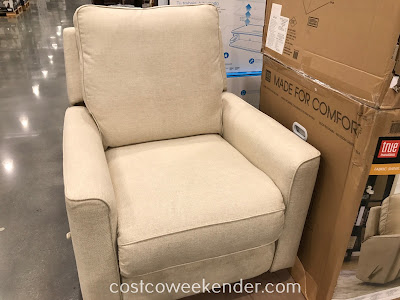Sit in comfort in the True Innovations Fabric Swivel Glider Recliner Chair