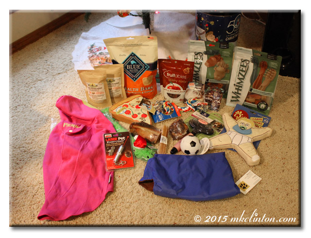 An assortment of dog toys, treats and jackets