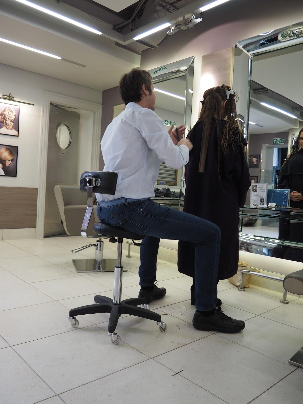 Richard Ward cutting a girls hair in the Chelsea Salon, London