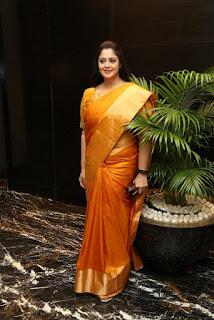 Actress Nagma In Yellow Saree 2019 At TSR TV9 National Film AwaEd's Navel Queens