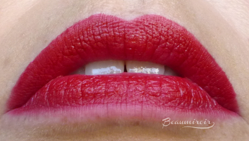 Lip swatch of L'Absolu Rouge Définition Lipstick by Lancôme in Le Carmin (195)