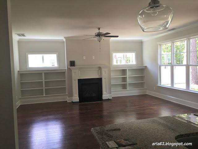 craftsman living room built-in shelves fireplace