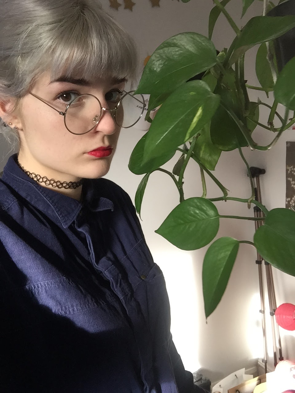 silver haired girl and pothos plant