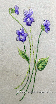 Society Silk Violets: a completed embroidered violet motif in antique silk floss