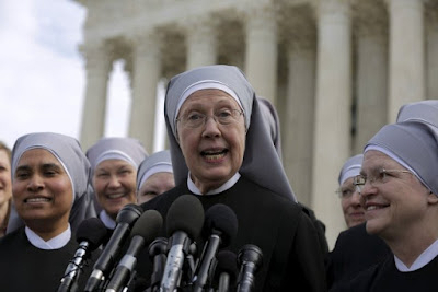 Sister Loraine Marie Maguire, mother provincial of the Denver-based Little Sisters of the Poor, speaks to the media outside the U.S. Supreme Court in Washington March 23 after attending oral arguments in the Zubik v. Burwell contraceptive mandate case. (CreditL CNS/Reuters.)