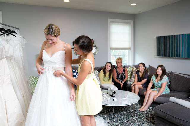 Bride and friends shopping for wedding dress