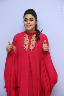 Actress Poorna Latest Stills in Red Dress at Rakshasi First Look Launch  0051.JPG
