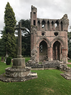 The cross of sacrifice near Douglas and Dorothy Haig's grave at Dryburgh Abbey