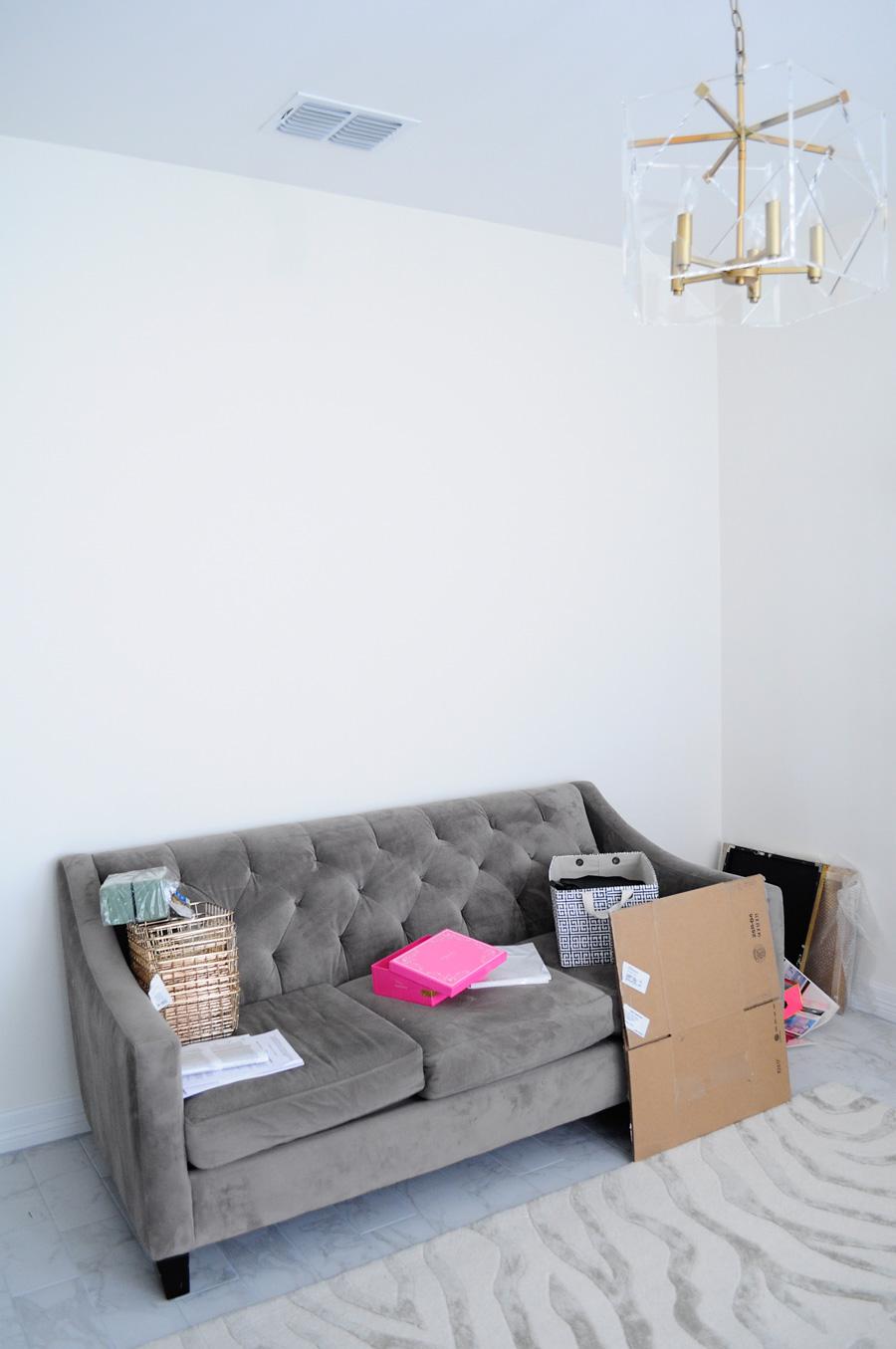 Tufted Chloe sofa along a white wall.