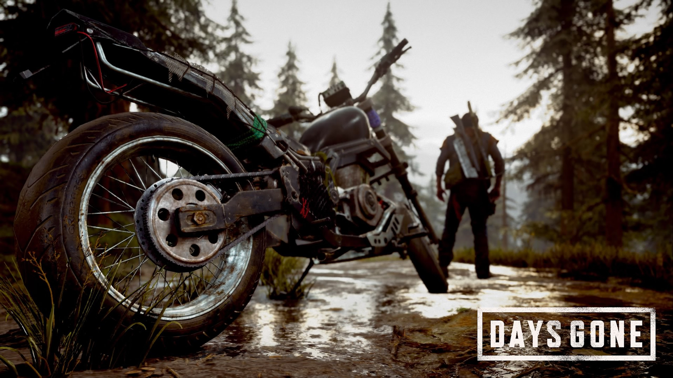Days Gone protagonist John Deacon standing in front of his bike