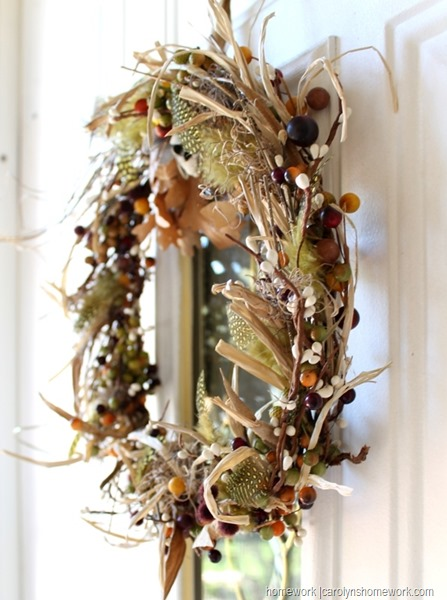 Scrapbuster fall wreath using feathers, berries and leaves