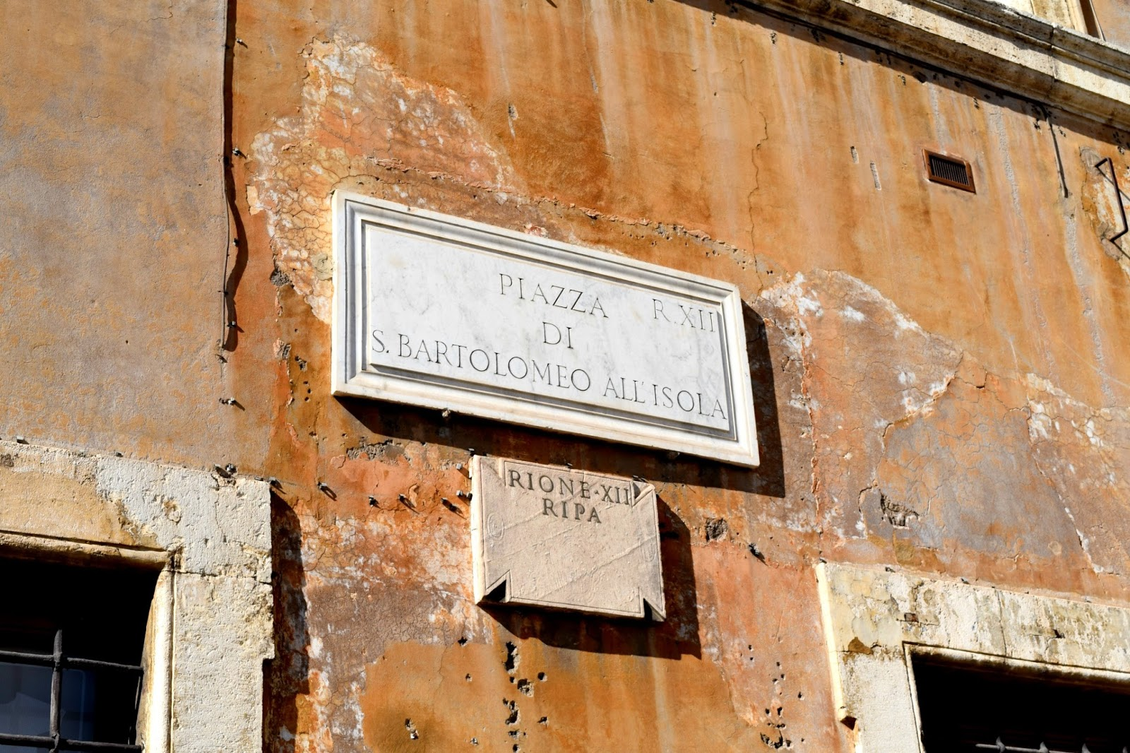ancient stone street sign in italy