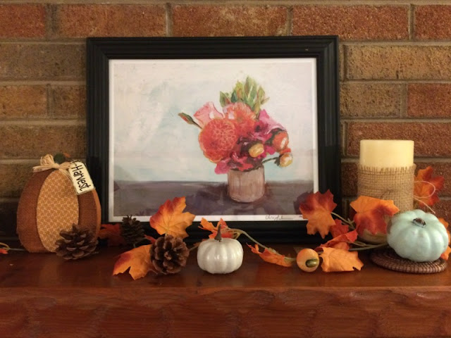 I enjoy mixing neutral shades with the traditional orange and yellows of fall to create a rustic fall mantel and wooden toolbox centerpiece.